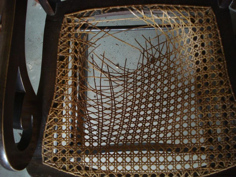 Need your cane seat rewoven? Chair caning repair help here!