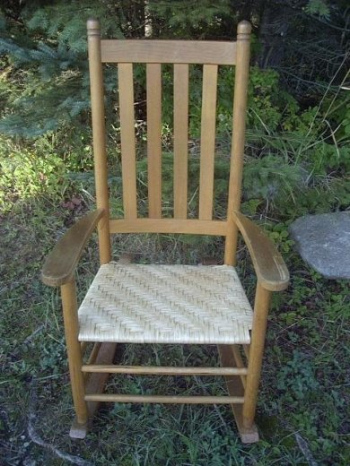 Handwoven splint seat in rocker.