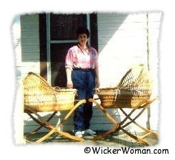 Two wicker baby bassinets by Cathryn Peters