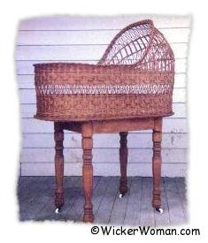 Fancy wicker bassinet on legs woven by Cathryn Peters
