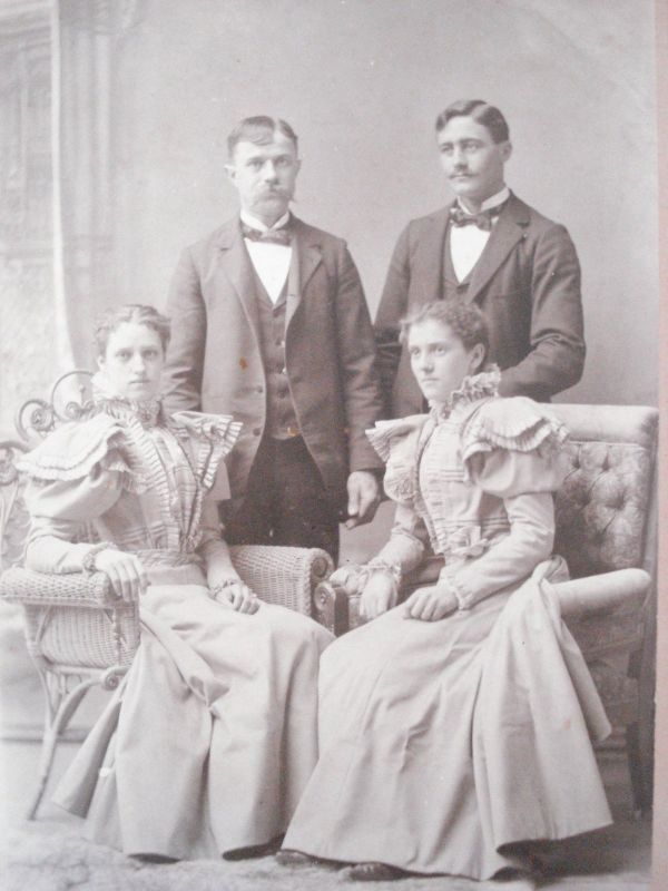couples posing wicker cabinet card