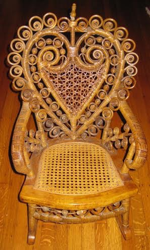 Heart motif child's wicker rocker