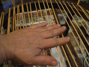 Proper chair caning strand tension