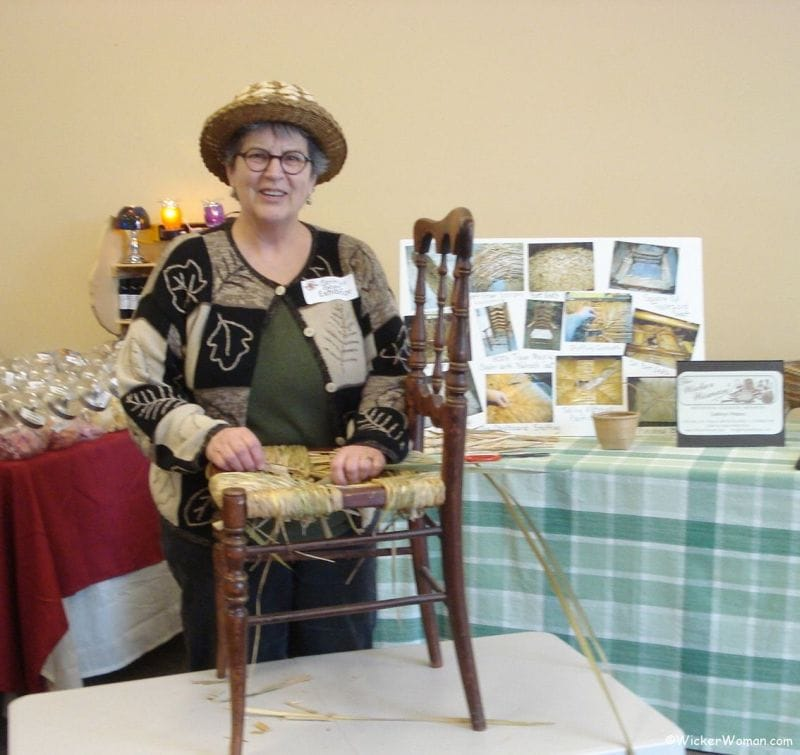 Cathryn Peters demonstrating how to weave a hand-twisted cattail rush seat.