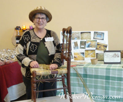 Cathryn Peters demonstrating hand-twisted cattail rush seat