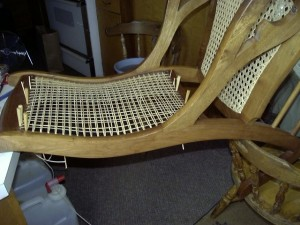 Chair caning a Lincoln rocker back.