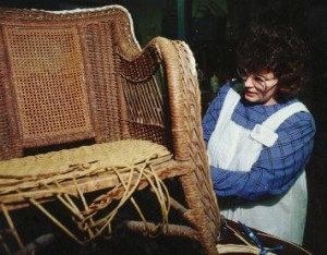 Cathryn repairing paper wicker rocker