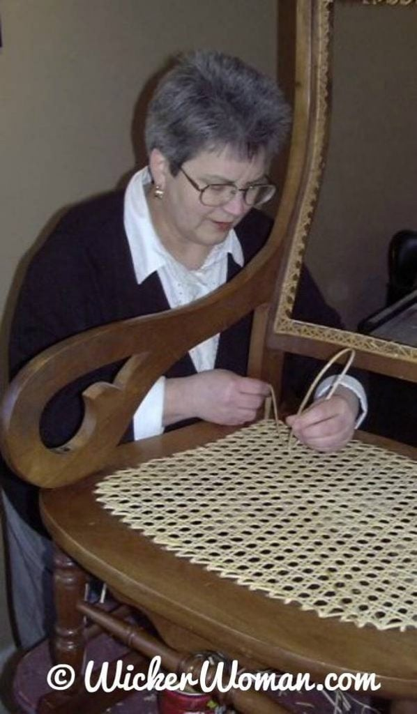 Cathryn Peters weaving hole cane seat