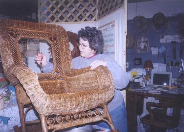 Cathryn repairing reed wicker rocker