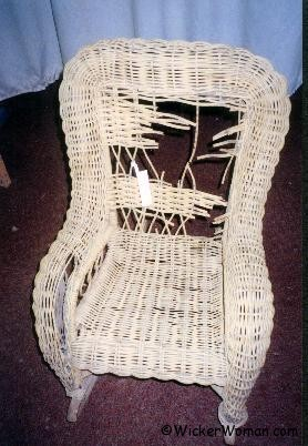 Child's wicker rocker before restoration.