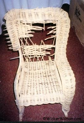 Child's wicker removing damaged areas of rolled arms.