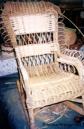 Spokes added to restore rolled arms on child's wicker.