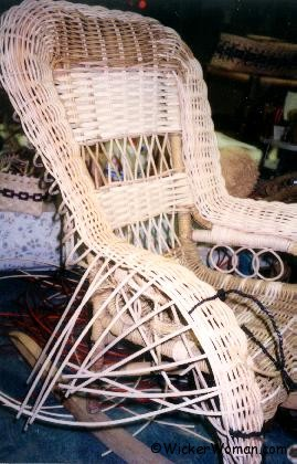 Replacing spokes on serpentine rolled wicker arm.
