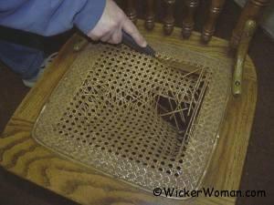 Cut out broken center of cane webbing.
