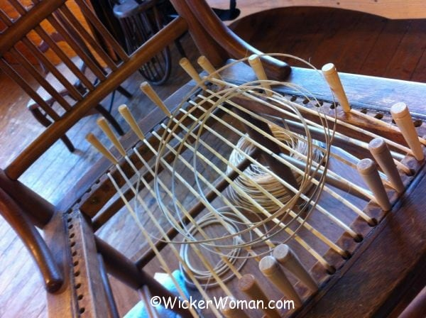 First step in hole-to-hole chair cane weaving