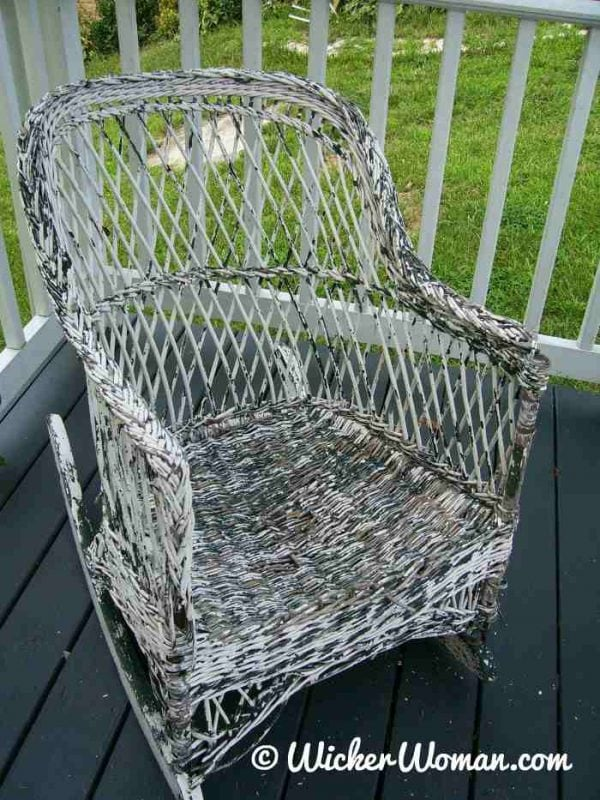 wicker reed rocker with flaking paint