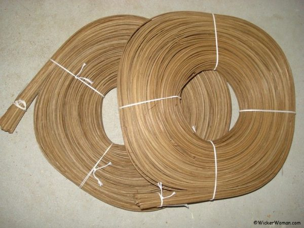Coils of flat-oval smoked rattan reed