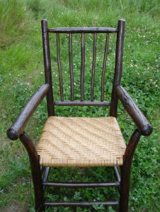 Rattan reed seat on rustic chair