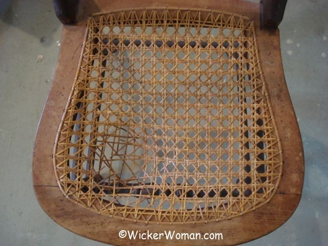 Hole-to-hole chair cane seat before removal
