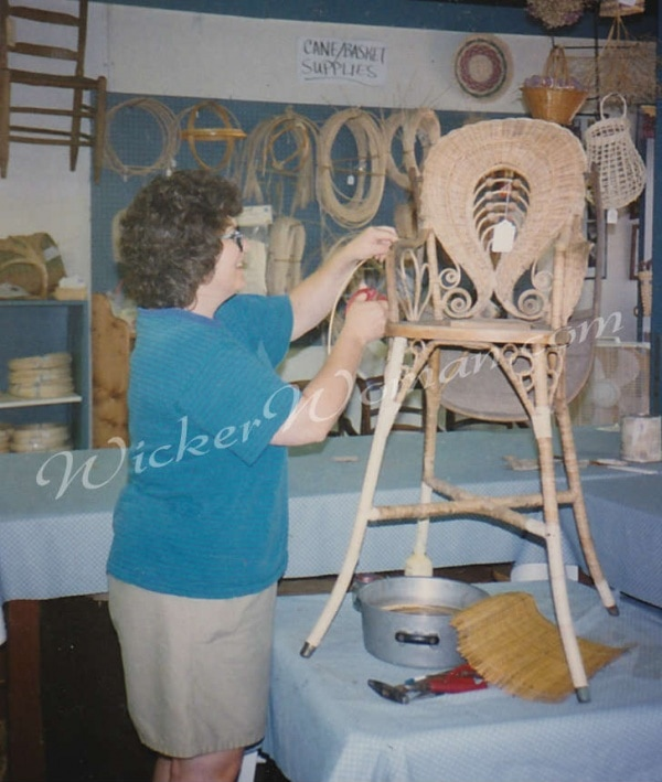 Peters repairing Victorian wicker highchair
