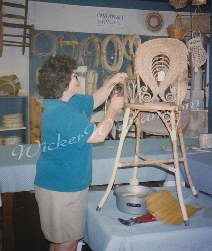 Peters repairing Victorian wicker highchair
