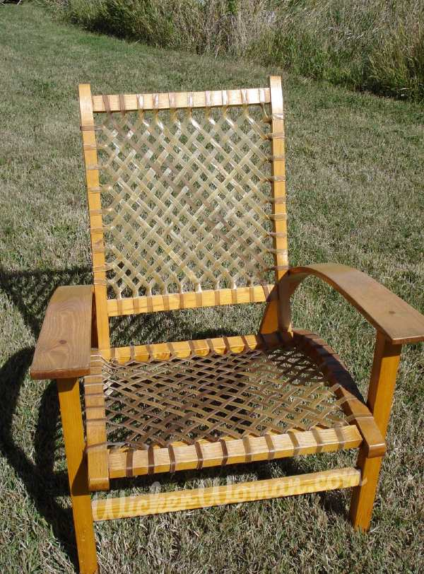 Rawhide woven on seat and back of Adirondack-style armchair.