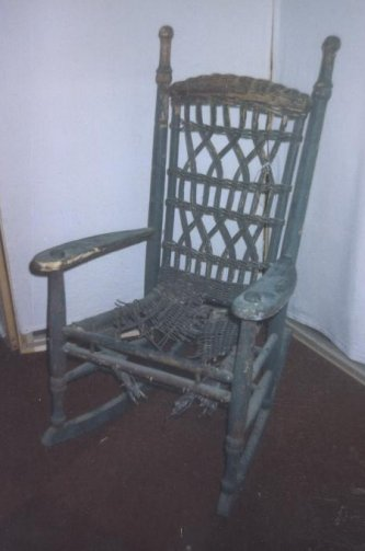 Damaged wicker rocker