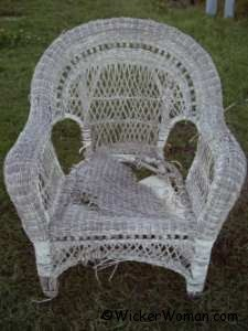 Reproduction wicker chair left outside for one season