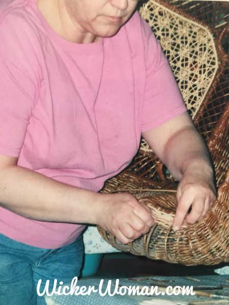 Cathryn repairing reed serpentine arm in Victorian wicker rocker