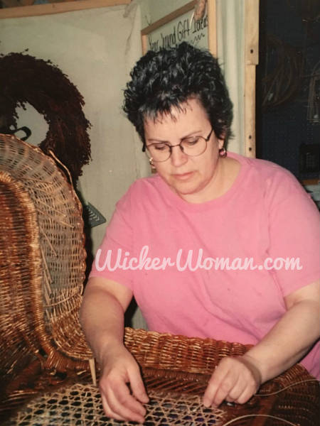Cathryn beginning to weave the Star of David Cane back in Victorian wicker rocker