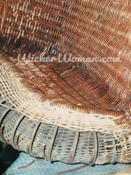 Spokes have been replaced and weaving serpentine reed wicker arm is beginning in Victorian wicker rocker