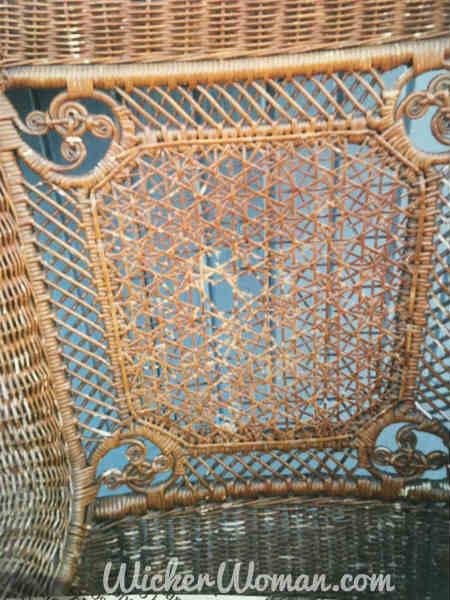 Damaged Star of David cane back in Victorian wicker rocker